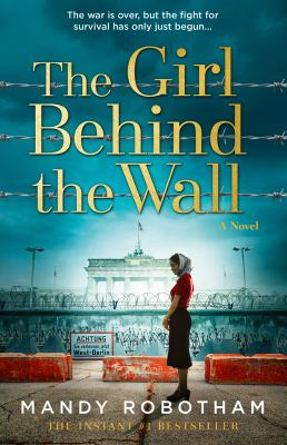 The girl behind the wall : a novel Book cover